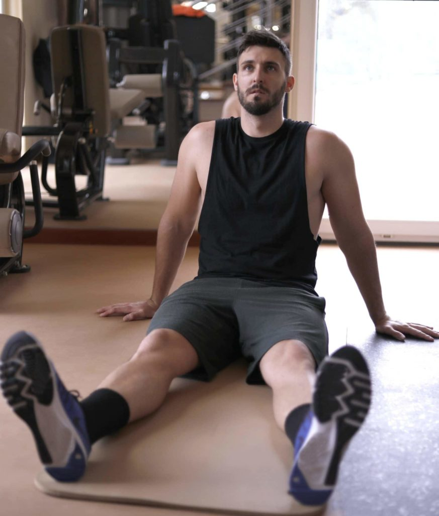 Guy sitting on floor after exercising
